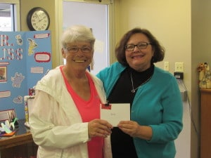 Connie Olson, Library Director awards Betty her winning prize.